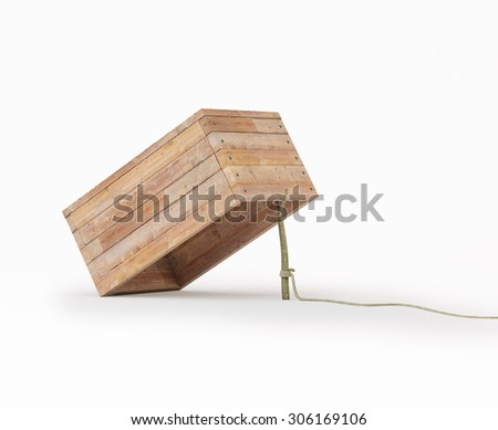 Trap made out of a box and a rope tide to a stick Foto stock ©