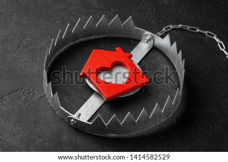 Trap with bait house. The risk of buying an old house. Dangerous mortgage. Home insurance. Black background #1414582529