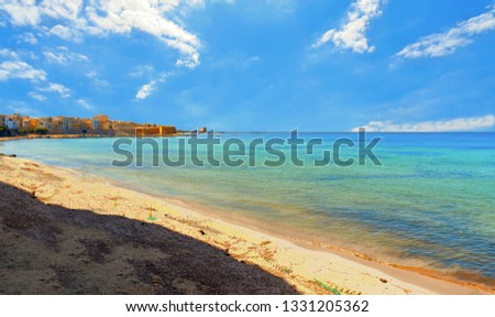 Trapani. Panoramic view of empty paradise turquoise beach near on waterfront and near city harbor, Sicily, Italy. #1331205362