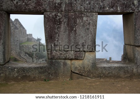Trapezoidal windows of a building at the abandoned citadel of Machu Picchu high up in the Peruvian Andes