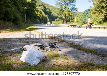 Trash and litter along the roadside and in nature.