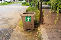 Trash bin in public park, garbage bin in the park beside the walk way, Litter bin in beautiful city park.