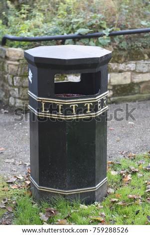 trash bin in uk park. black and ...