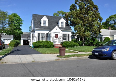 Trash Can Curbside Suburban Two Story Cape Cod House Residential Neighborhood