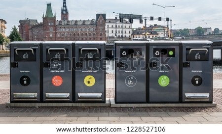 Trash containers for different rubbish in the center of Stockholm, Sweden. Waste collection in Europe for subsequent recycling, eco friendly waste collection