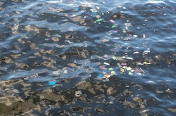 Trash in sea water. Plastic bags in ocean. Ecological problem. Urban seaside pollution. Human activity influence to wild life and natural environment. Garbage in seawater. Marine pollution in Asia