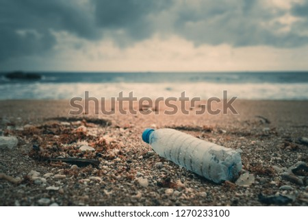 Photo of Trash, plastic, garbage, bottle... environmental pollution on the beach. Royalty high-quality free stock photo image of trash, plastic bottle on the beach. Waste that polluted the ocean environment
