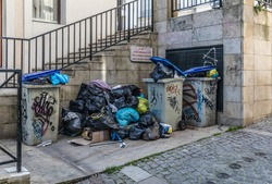 Trashs and trash bags in the street during a strike of the garbage collectors