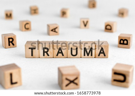 Trauma - words from wooden blocks with letters, physical or mental injury trauma concept, white background Foto d'archivio ©