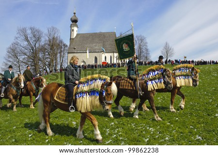 TRAUNSTEIN, GERMANY - APRIL 9: biggest annual catholic horse procession at easter, named - Osterritt - Georgiritt - in bavarian city Traunstein with 400 horses at April 9, 2012 in Traunstein, Germany