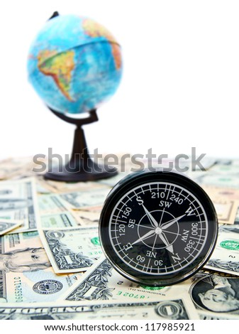 Travel. A compass and the globe on money.