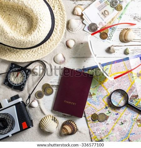 Travel accessories on wooden table - Shutterstock ID 336577100