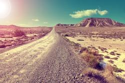 Travel and adventures through remote desert landscape.Desert landscape and road.Sunset scenic