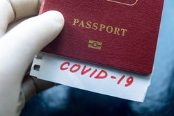 Travel and coronavirus concept, COVID-19 mark in tourist passport. Medical test at border control due to coronavirus. Business and tourism hit by novel corona virus, restrictions during pandemic.