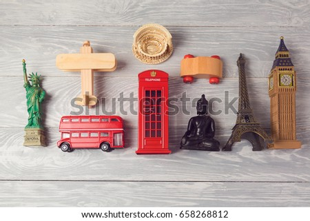 Shutterstock Travel and tourism background with souvenirs from around the world. View from above. Flat lay