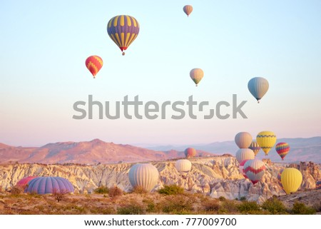 Travel and tourism by Turkey. Famous sightseeing Cappadocia, Anatolia. Beautiful landscape with mountains, caves and baloons in the sky. #777009700