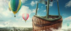 Travel and Tourism. Colorful hot-air balloons flying over the mountain. Close view on basket