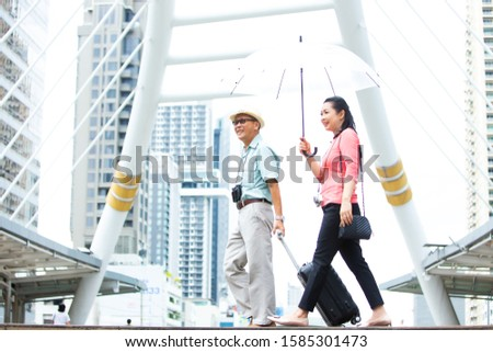 Travel and tourism concept. Happy Asian Elderly couples peoples walking in the city enjoying travel trip