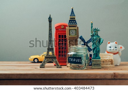 Travel and tourism concept with souvenirs from around the world. Planning summer vacation, money budget trip concept. Saving money for vacation.
