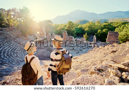 Travel and tourism. Senior family couple enjoying view together on ancient amphitheater.