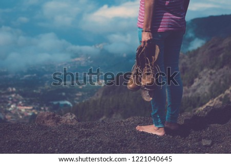 Travel and wanderlust explore and enojy the world discovering scenic place for alternative vacation or millennial traveler lifestyle concept image with girl standing with a broken trekking shoe #1221040645
