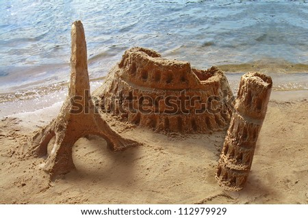 Travel around the world. Famous landmarks made of sand - Coliseum, Eiffel tower, Pisa tower