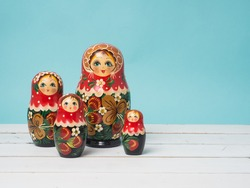 Travel around the world for your colorful life .Enjoy the funny trip journey .Top view for copy space some idea your create destination .object  cute  ,  Set of matrioshka dolls on color background.