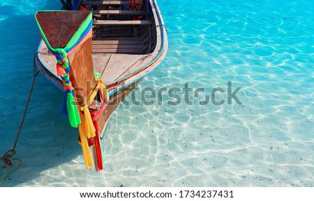 Travel background. Beautiful Thailand tropical sand beach view with decorated traditional longtail boat. Vacation day tour from Phuket to Ko Phi Phi Don island, Phi Phi archipelago, Krabi, Andaman Sea