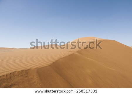 travel background with a sand dune in the Namib desert, Namib Naukluft Park, Namibia, Africa