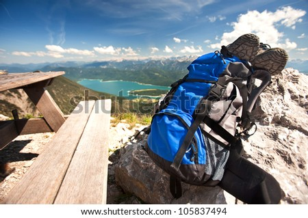 Travel backpack and shoes in the background of mountain landscape