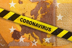 Travel ban and Coronavirus quarantine in Europe. Concept. 50 Euro banknote with EU map and yellow tape. Economy markets impacted by corona virus COVID-19 pandemic. Concept. Montage.