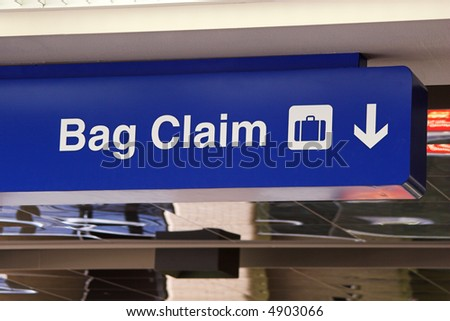 Travel. Blue baggage claim sign at an airport.