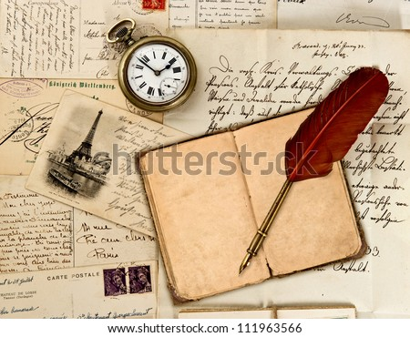 travel book diary, old letters, post cards and feather quill ...