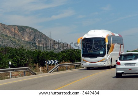 travel bus and car driving along the highway