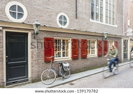 Travel by bicycles on old town of Amsterdam - Netherlands, Europe.