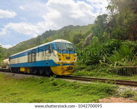 Travel by train Diesel rail in Thailand.