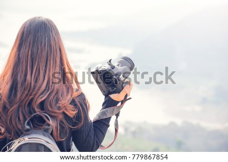 travel camera woman in black...