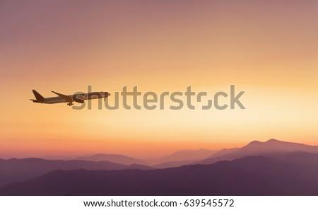 travel concept background, airplane in sunset sky, international flight