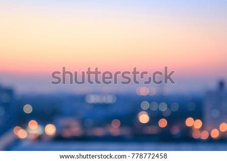 Travel concept: Bokeh light and blur city skyline autumn sunrise background