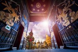Travel concept, Giant statue at Temple Wat Pra Kaew, Grand Palace, Bangkok Thailand