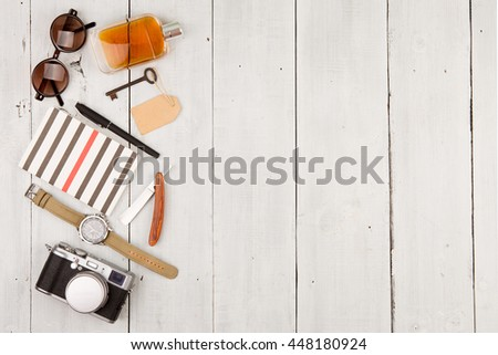travel concept - set of cool stuff with camera and other things on wooden table #448180924