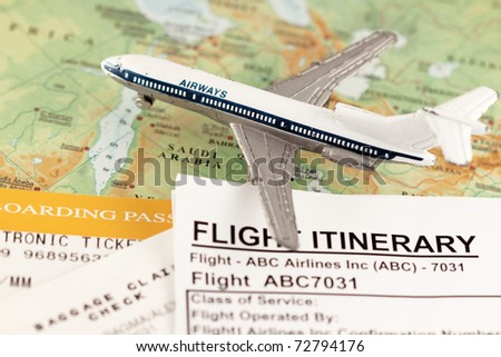 Travel concept to middle east - with flight itinerary, boarding pass and baggage claim