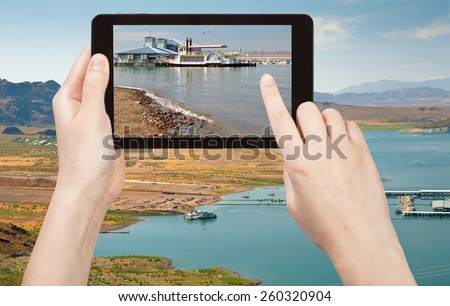 travel concept - tourist taking photo of recreation area on Lake Mead on mobile gadget, Nevada, USA