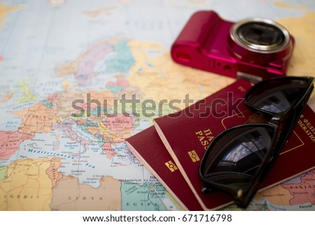 travel concept, two passports. glasses and camera on the map, travel planning, time to travel, euro trip, trip together #671716798