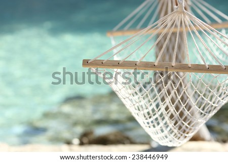 Travel concept with a hammock in a tropical beach with turquoise water in the background #238446949