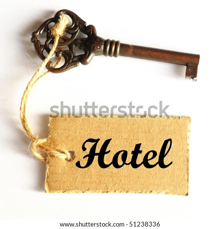 travel concept with hotel key and tag or label