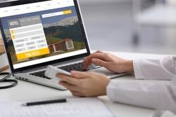 Travel concept. Woman using laptop to plan trip