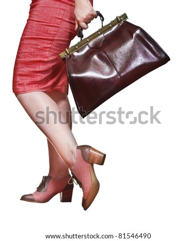 Travel concept. Woman with baggage. Isolated on white