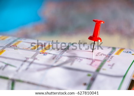 Travel destination pin points on a map with colorful thumbtacks and depth of field with select focus. #627810041
