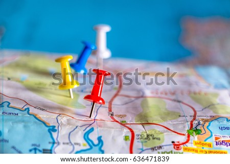 Travel destination pin points on a map with colorful thumbtacks and depth of field with select focus. #636471839